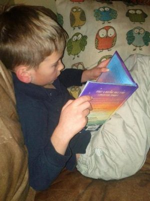 One of my grandsons reading Words to Dream On two years ago